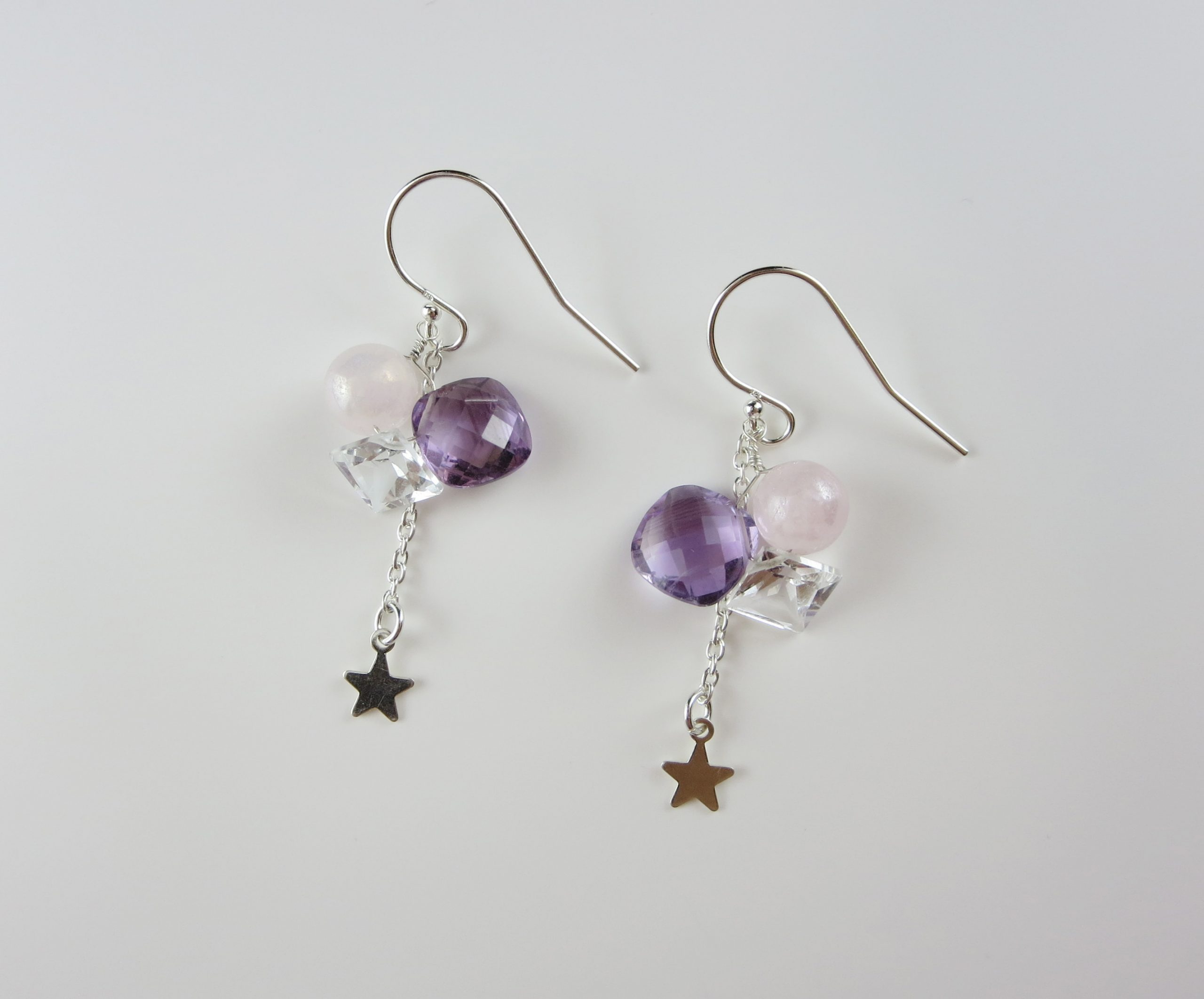 Amethyst star motif silver earrings